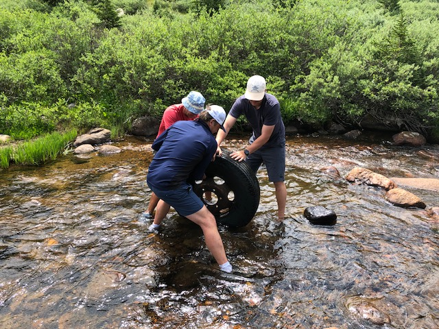 Removing a 300lb (debris-filled) tire from the headwaters of the Roaring Fork River