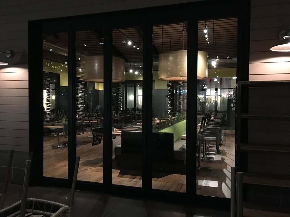 COMMERCIAL IRON AND GLASSDOOR 3  Commissioned by Sam Fox Resturants, Nelson Partner Architects designed the True Foods Restaurant in Scottsdale Quarter to literal open wide 3 of the 4 sides of this restaurant with 10 of our  engineered and fabricated trackless Multi folding  steel and glass doors.