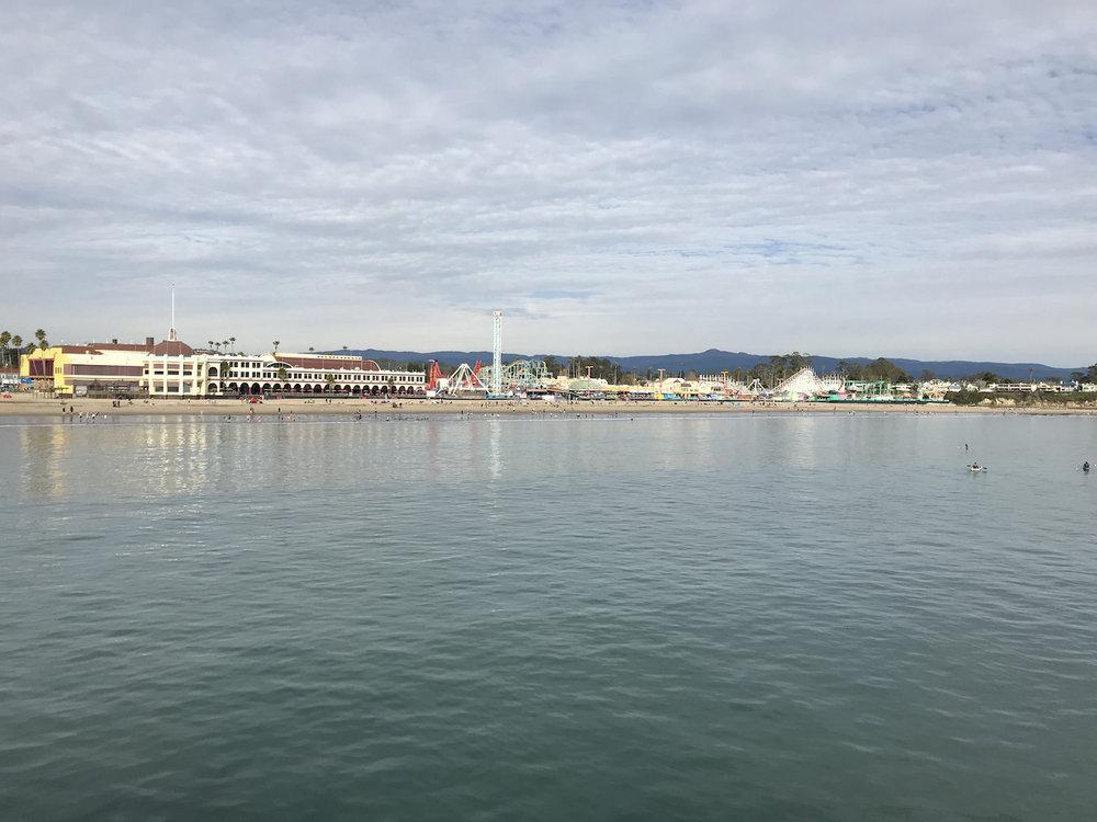 The Santa Cruz Beach Boardwalk visible from the Santa Cruz Wharf and a short walk away