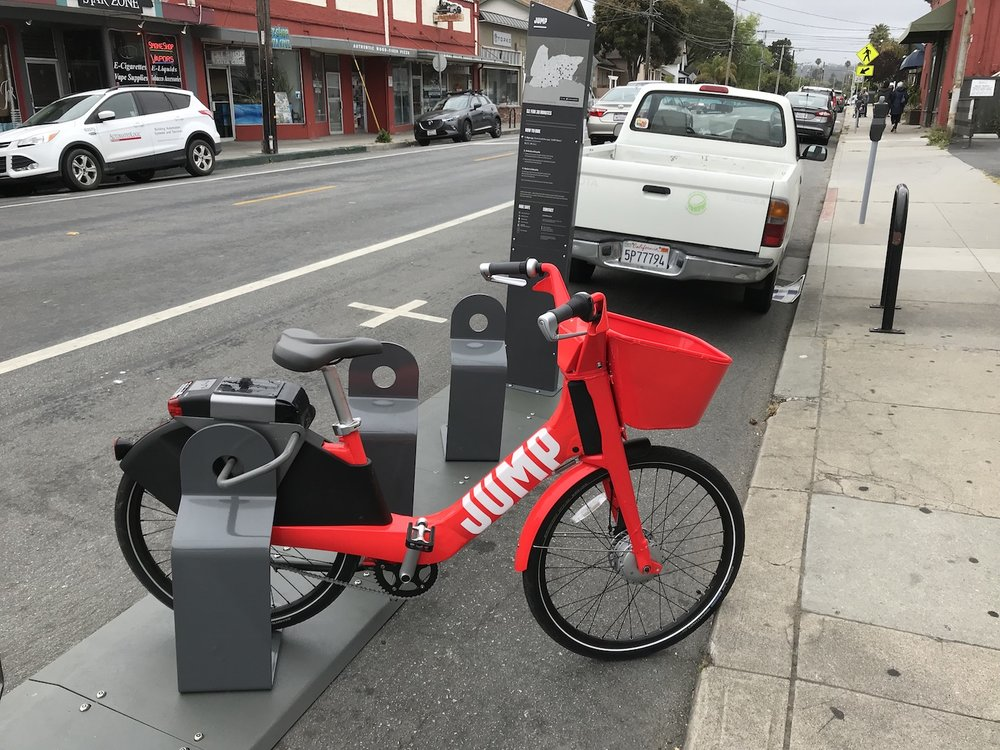 A JUMP Bike dock located on Seabright Avenue in Santa Cruz near La Posta Restaurant.