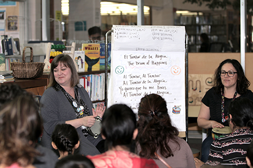 Susan Goetz (L) and Raquel Metcalfe (R) captivate two to four-year-olds with bilingual story time every Tuesday morning at the San Bruno Library.