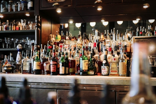 Full bar with stocked liquor cabinet at dive bar
