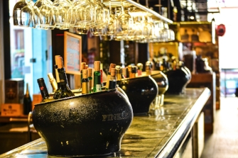 Ice buckets of wine and beer in bar on bar countertop
