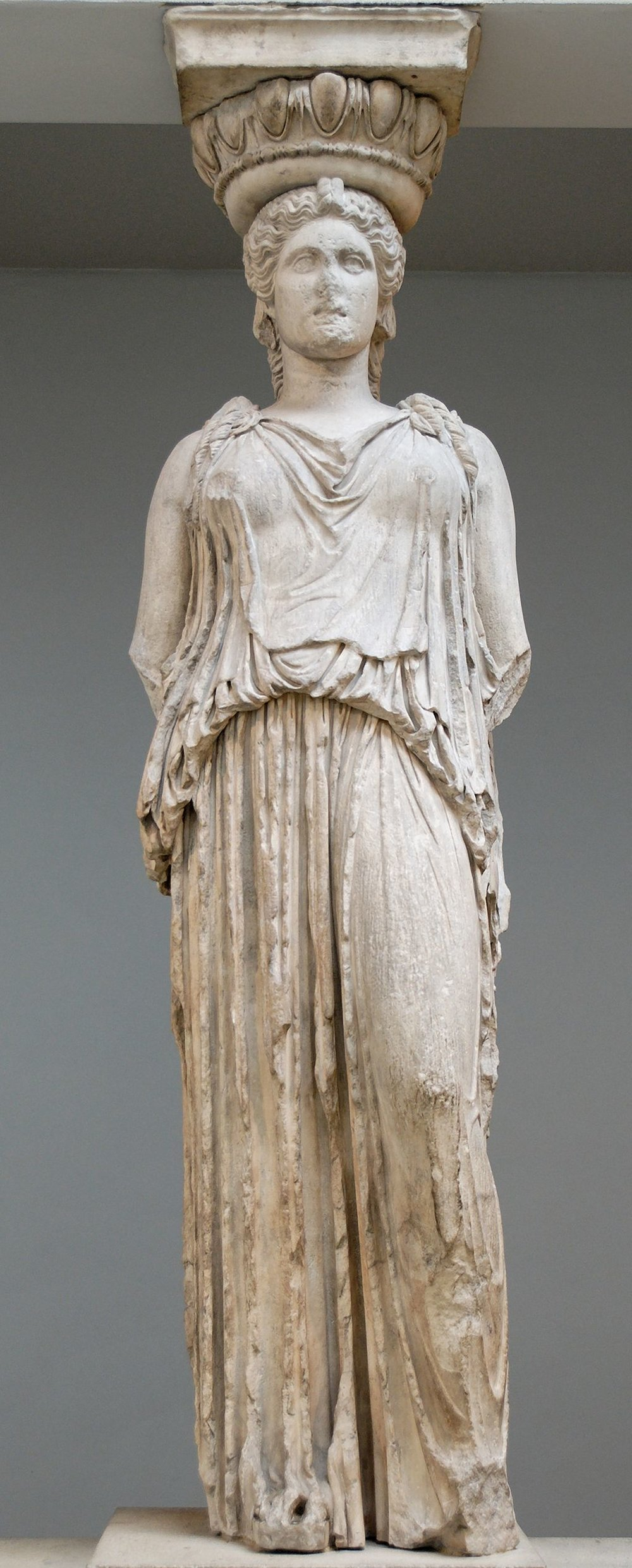 Caryatid wearing a Chiton at the Erectheion - Photo Courtesy of Wikimedia Commons