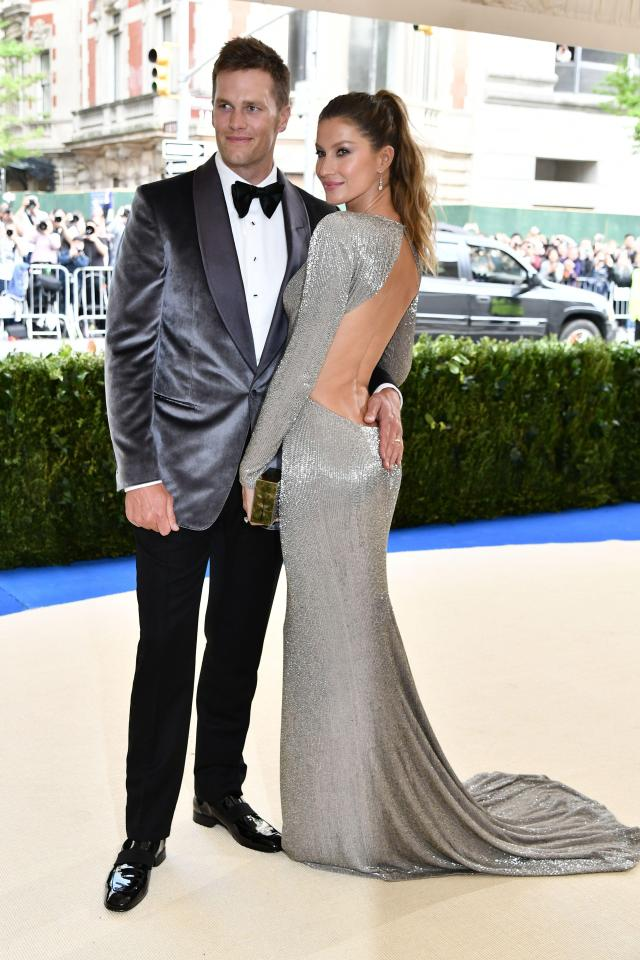 Gisele Bündchen in Stella McCartney and Tom Brady in Tom Ford.