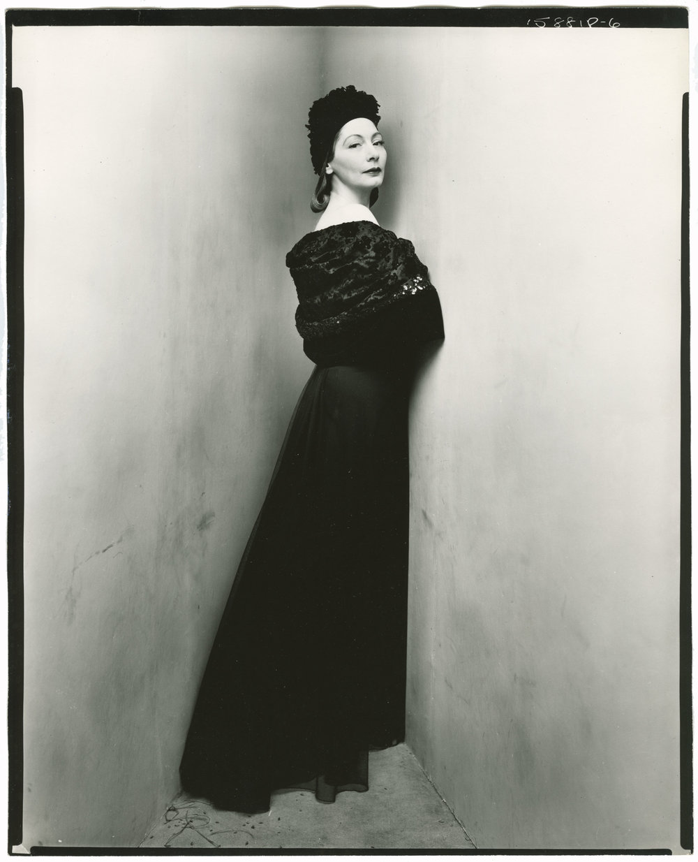 "Valentina in a timeless, long-sleeved black gown. This photograph was taken by Irving Penn as a part of his ""Corner Portrait"" collection in 1948 where he would have prominent celebrites, politians, artists, musicians, dancesrs, and writers pose in this corner studio. The angle sharper than 90° and created an ""artifical corner of the world."" Image courtesy of socks-studio.com"
