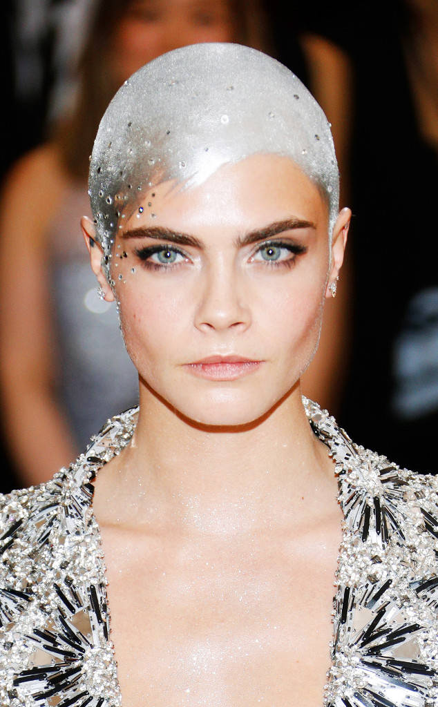 Delevingne rocking the painted silver hair at the Met Gala this year. Photo courtesy of eonline.com.