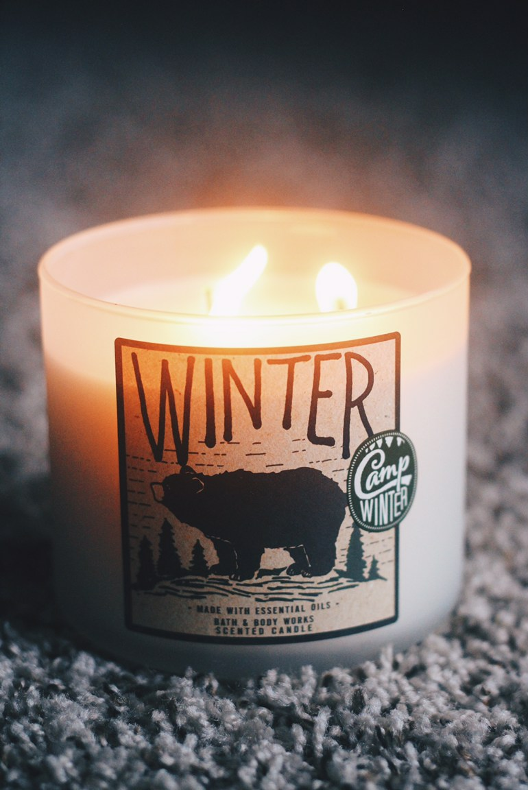1. Winter  - The name says it all: This candle reminds me of all things winter. It's made with orange and fir needle oils, along with clove, and it smells like a cobbler in the oven with a fire going in the fireplace and Santa coming down the chimney, all at the same time. I'm not even kidding, y'all.Retails for $24.50, but currently on sale for $12.50