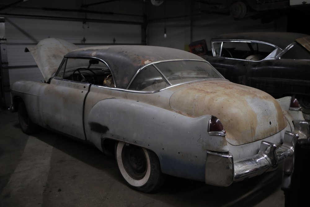 Here's the Coupe DeVille in the garage where we bought it, getting ready to be put onto the flatbed.