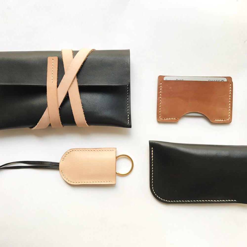 traditional leatherwork, saddle-stitched leather goods, keychain, wallet, clutch, sunglasses case