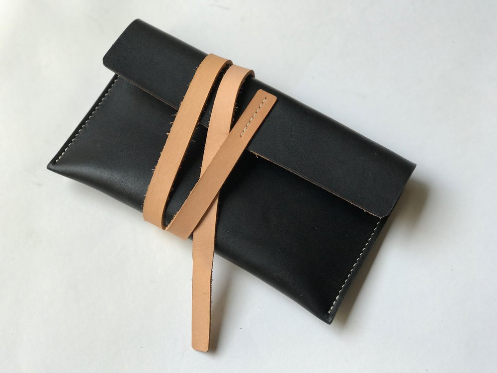 traditional leatherwork, saddle-stitched leather good, wallet, clutch
