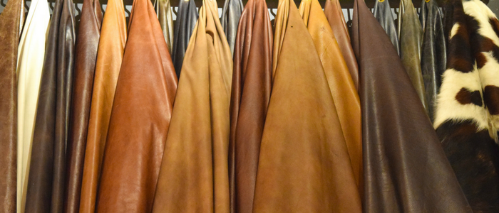 brown and tan leather hides hanging, things to know before buying leather hides