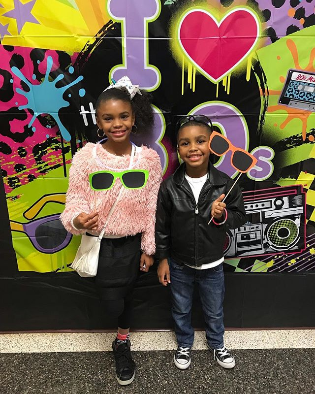 Michal and Micah are at their first school dance tonight at #MtPleasant�Elementary� The theme is back to the 80s!  They grow up so fast!  We didn't have night dances when I was in school, especially elementary school!  Thank you to the teachers for putting this together they are having a great time.  #family #dance #80s #schooldance