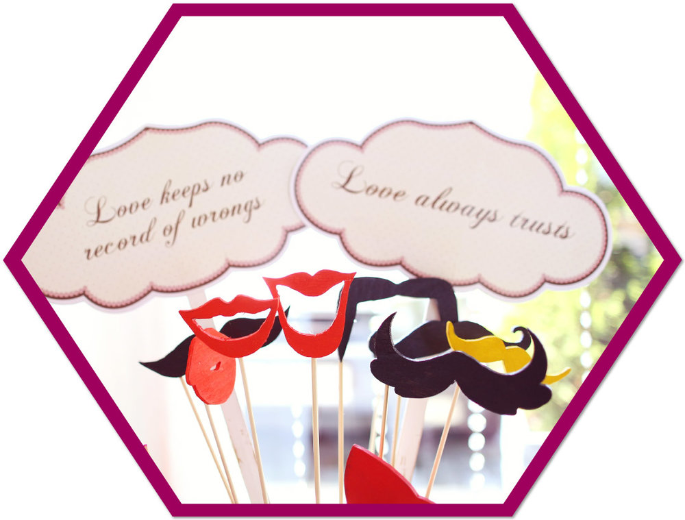 Photo Booth Props - Your photo booth rental includes 40+ props including hats, glasses, emoji signs, smooch lips, mustaches and more. You can also provide your own themed props.