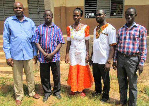 One of the Thriving Tailor vocational programme students with the Headmaster of Bethel School, Burkina Faso, the Director of AEAD, our NGO, the representative of the parents' association and the sewing teacher.