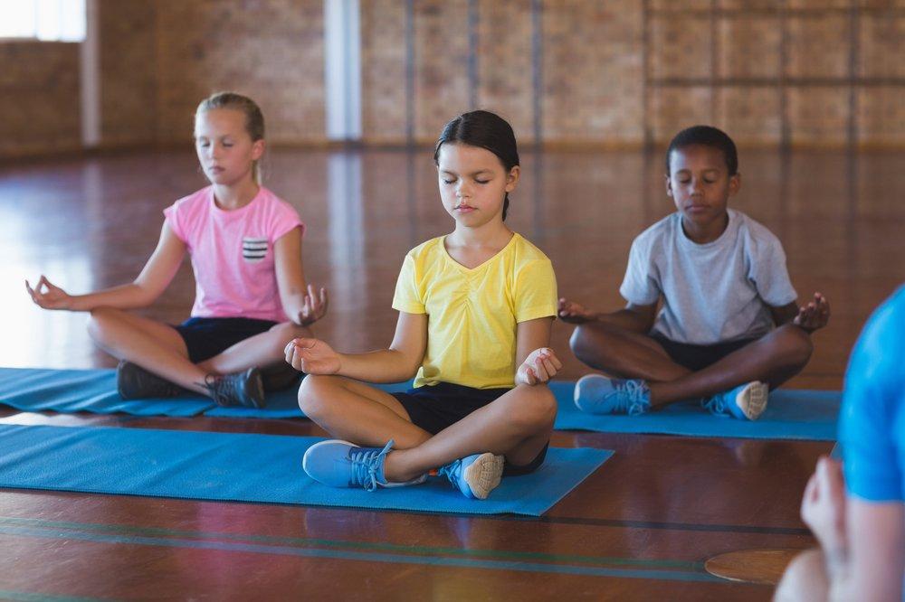 Meditating children in gym.jpg