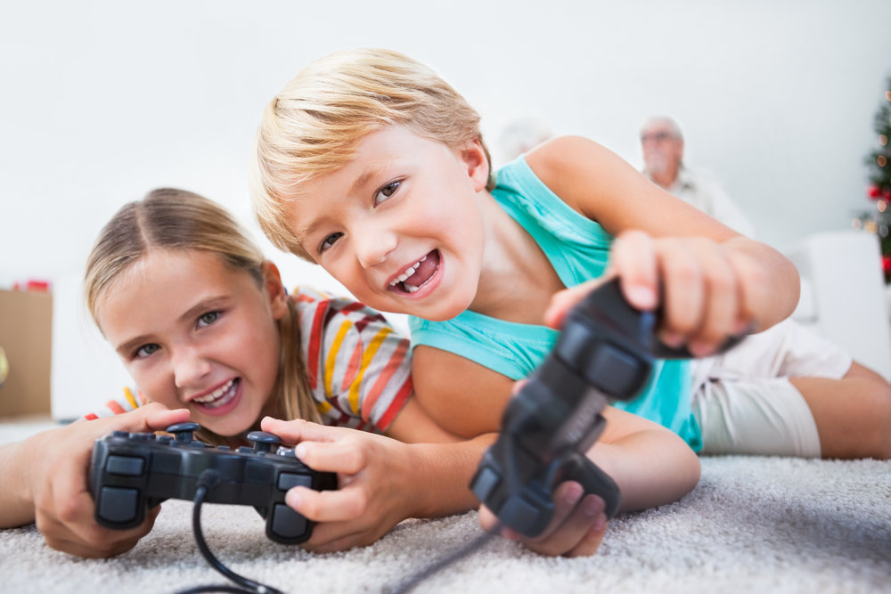 Two children are learning through video games.