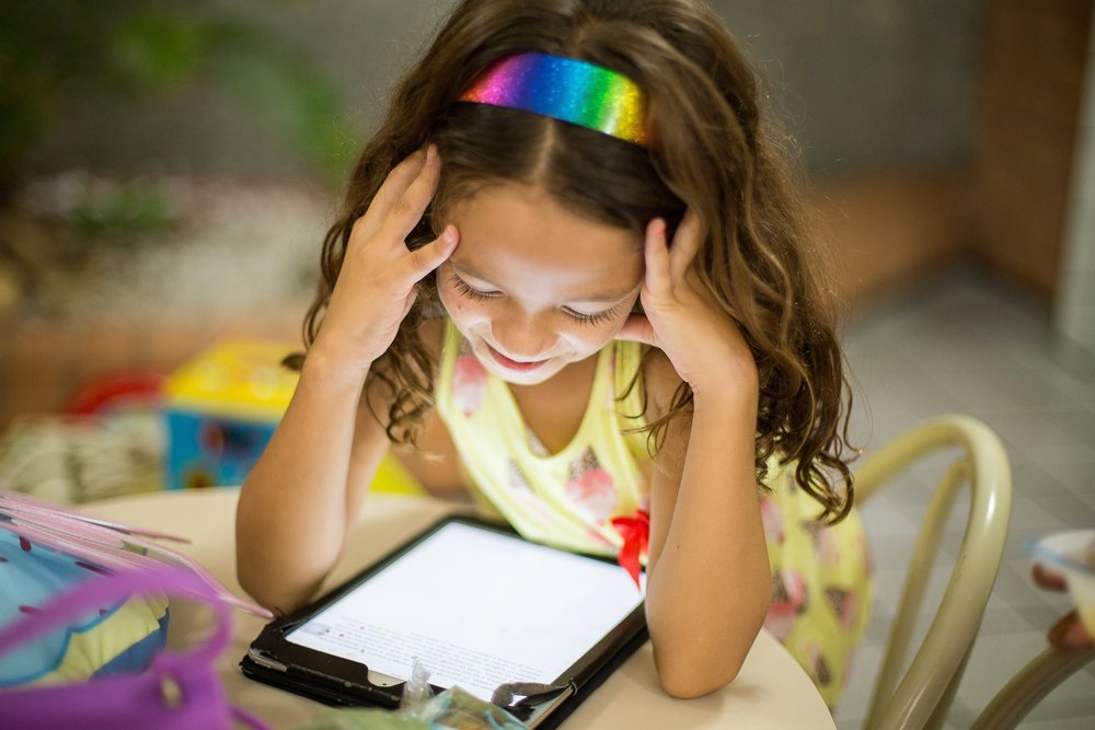 Generation Z child uses tablet for personalized learning in a classroom
