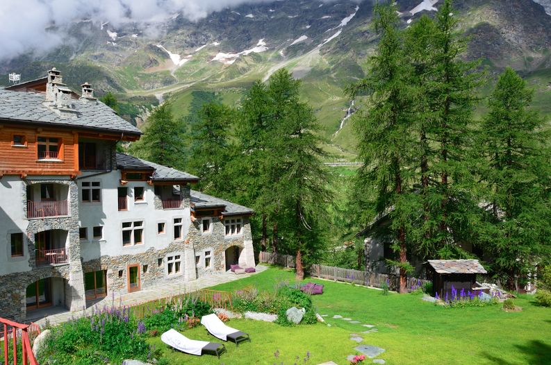 The backyard of the Saint Hubertus Resort with first class views of the Klein Matterhorn
