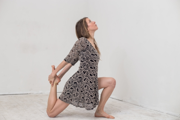 Practicing an Anjaneyasana variation to open up the upper thighs