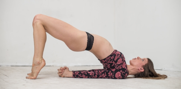 The Bridge Pose is an excellent position for men to receive analingus / Photo by Paulo Salud