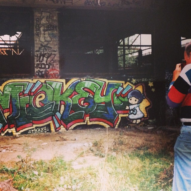Groningen 1992.   James Prigroff  (Spraycan Art) photographing a Mickey piece.