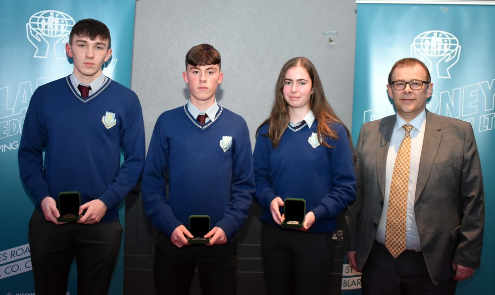 Junior Certificate Medal Winners: Mark Maguire, Niall Cremin and Aideen Donovan. (Pictured with Mark McGloughlin - BOM and Blarney Credit Union)