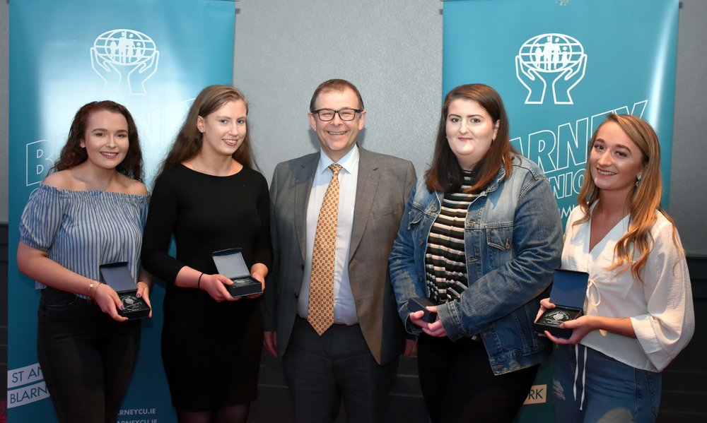 Senior Subject Award winners: Áine Dewale (History), Carol Donovan (Accounting), Ciara O' Connell (Business), Sophie Williams (Economics) (Pictured with Mr Mark McGloughlin - BOM and Blarney Credit Union)