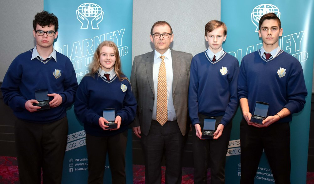 Junior Subject Award winners: Cian Lawrence (French), Seona Osborne (CSPE), Aaron Murphy (Geography), Valentin Petrov (History) (Pictured with Mr. Mark McGloughlin - BOM and Blarney Credit Union)