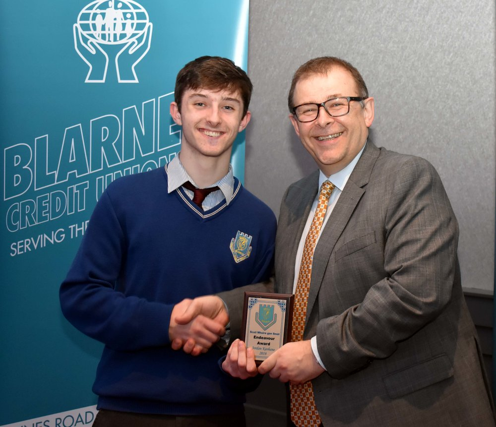 Jordan Keohane accepting an endeavour award as he represented Ireland and the school when he recently travelled to Slovenia to attend an international conference with the European Youth Parliament. (Pictured with Mr. Mark McGloughlin - BOM and Blarney Credit Union)