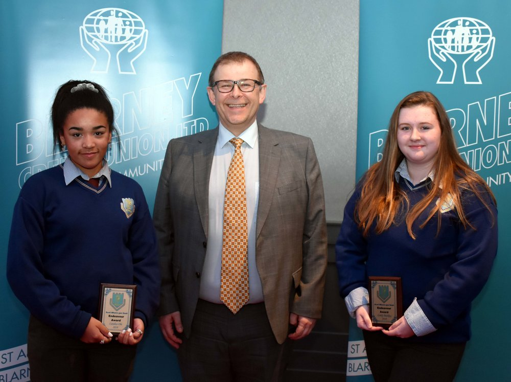 Candice Obi and Emily Buckley are the receipents of an endeavour award for representing their country in the European Baton Twirling Championships last summer. (Pictured with Mr. Mark McGloughlin - BOM and Blarney Credit Union)