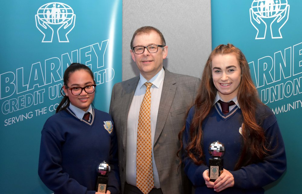 Luci Kelleher and Ava Moynihan receiving an endeavour award for representing Ireland in the Dance World Cup in Barcelona. (Pictured with Mr. Mark McGloughlin - BOM and Blarney Credit Union)
