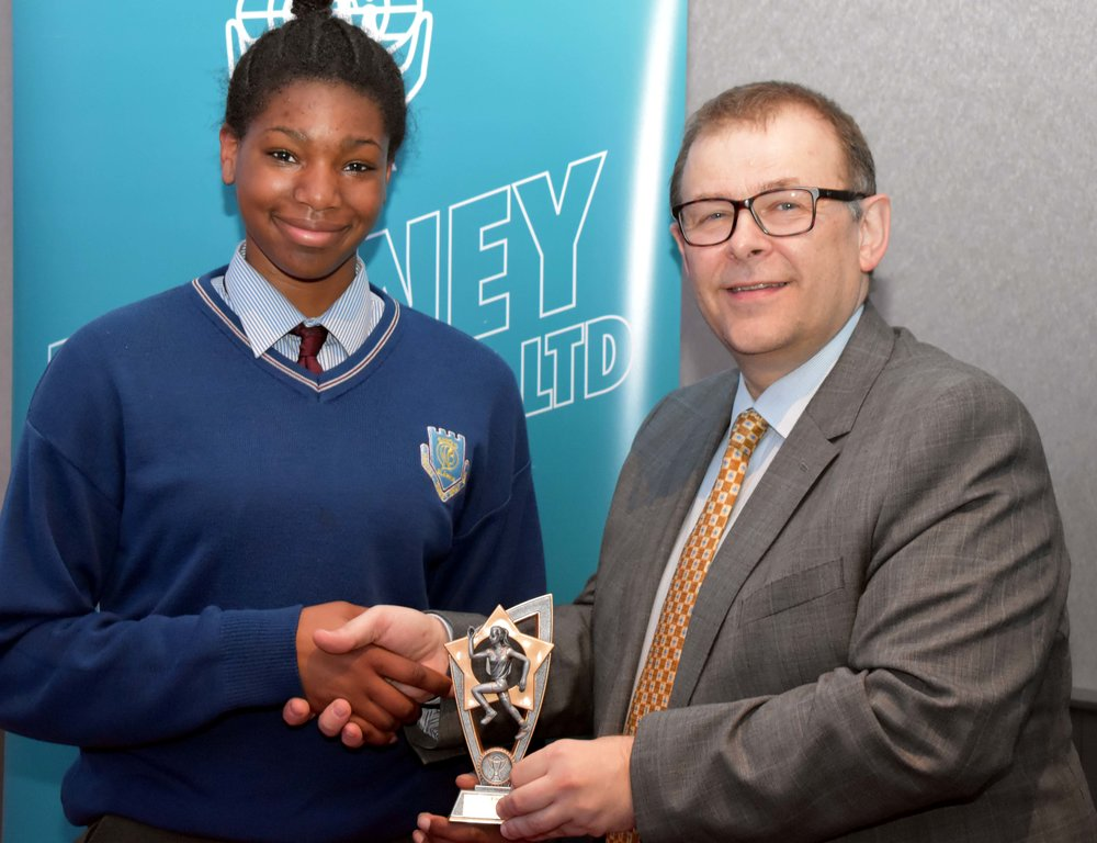 Michelle Ugwah receiving an endeavour award for winning the All Ireland Long Jump whilst representing the school. Michelle also won a Basketball All Ireland Final with her club Brunell. (Pictured with Mr. Mark McGloughlin - BOM and Blarney Credit Union)