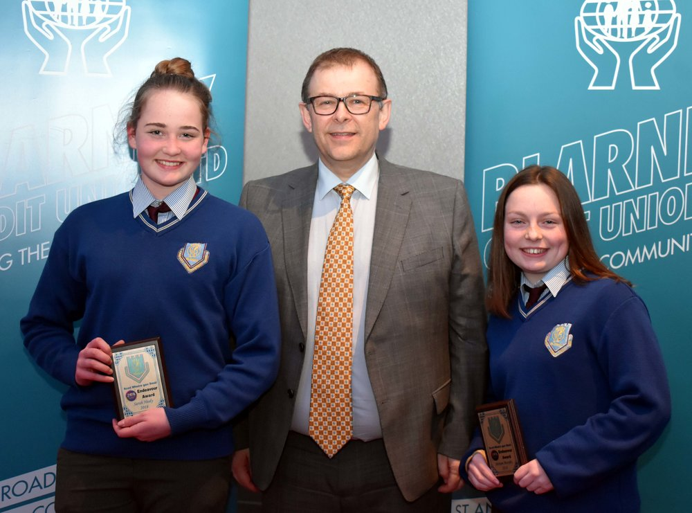 Sarah Healy and Miriam Murphy receiving an endeavour award for coming first in their category in the BT Young Scientist Competition 2018 with their project 'The positive and negative effects of Type 1 Diabetes on children' (Pictured with Mr. Mark McGloughlin - BOM and Blarney Credit Union)