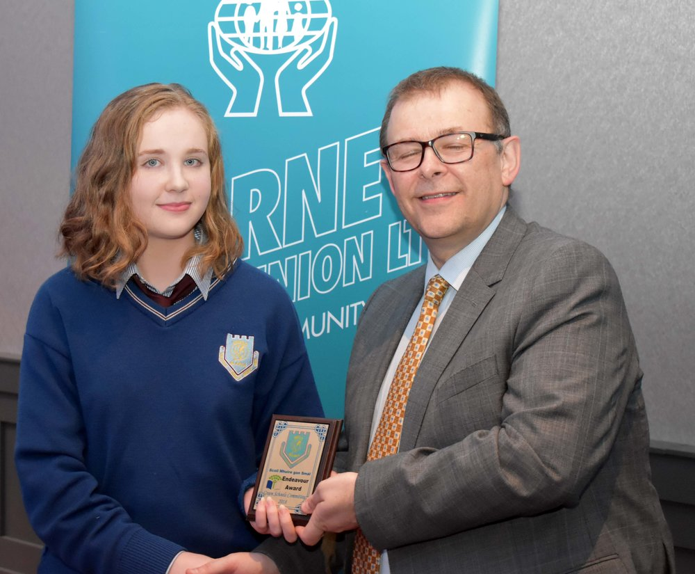 Green Schools Committee receiving an endeavour award for working hard and gaining a third Green Flag for SMGS. Megan Flynn accepting the award on behalf of the committee. (Pictured with Mr. Mark McGloughlin - BOM and Blarney Credit Union)
