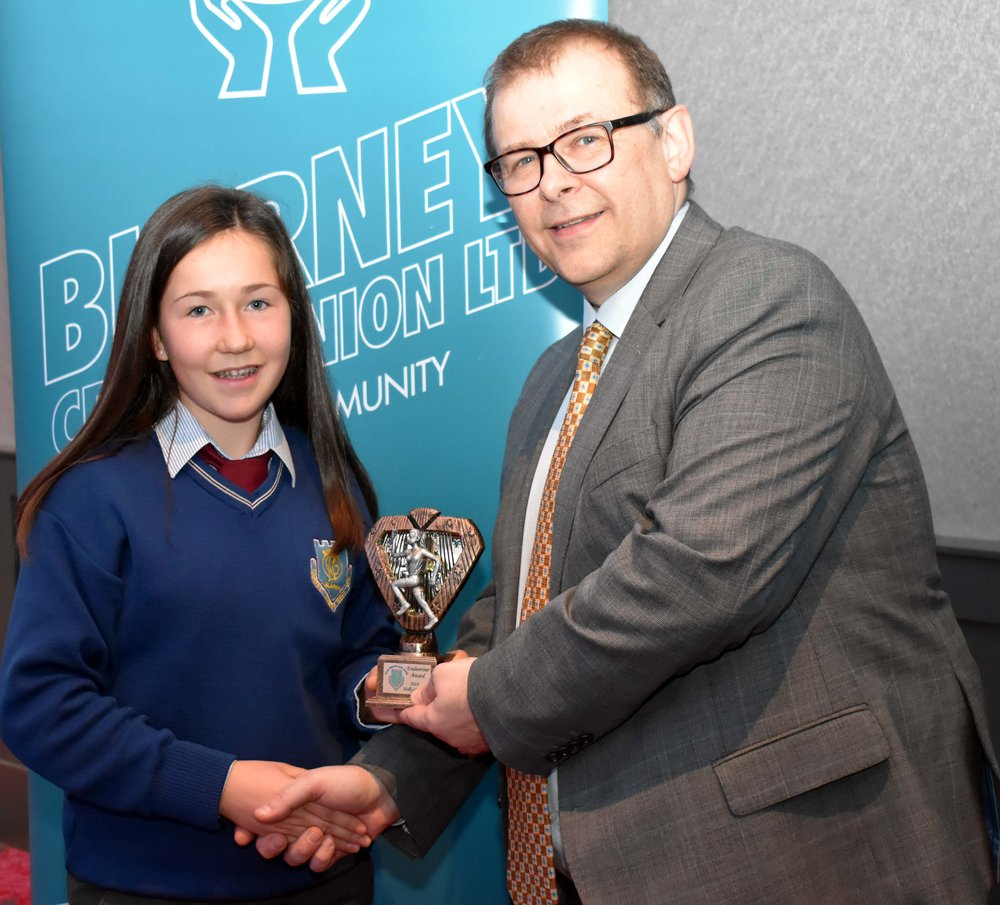 Holly Carroll receiving an endeavour award as she represented Cork Team which came 2nd in the All Ireland Cross Country last November. (Pictured with Mr. Mark McGloughlin - BOM and Blarney Credit Union)