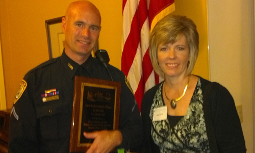 Officer Wagoner with wife Patty receiving Officer of the Year Award