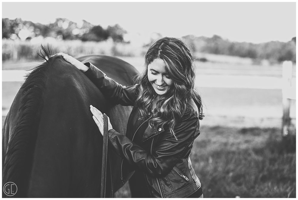 Girl looking down at horse