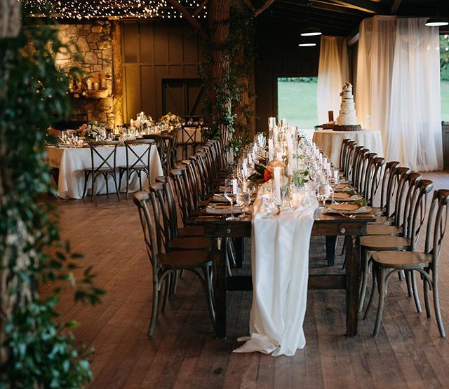 A chilly October day made to feel warm and cozy by twinkling candlelight. Beautiful photography by @juliawade . . Planning: @eventsbyelizabethashley // Venue: @theeseeolalodge // Cake: @christinabannercakes // Linens & Draping: @partytables_linensanddrapery