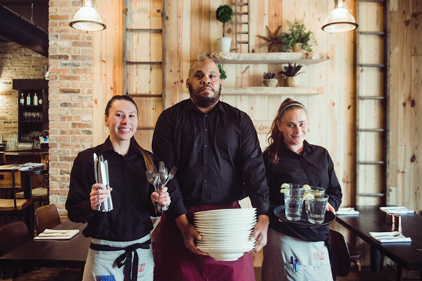 Light House Bistro employees (from left) Alex Tingler, Damon Blake and Brandi Kelley all graduated from the Light House training program.