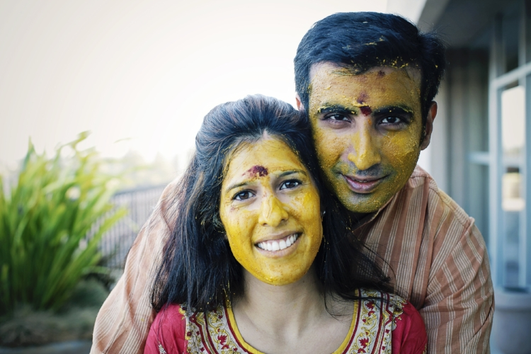 The glowing bride and groom at the haldi ceremony