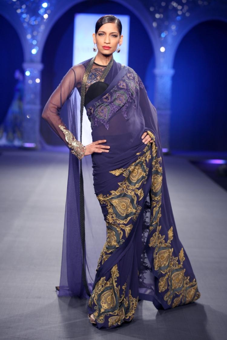 Royal purple and gold embellish this wedding sari