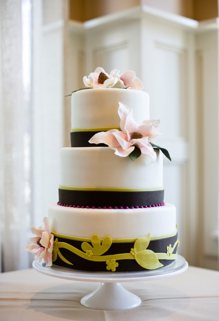 A serene color scheme and sugar cherry blossoms top this cake