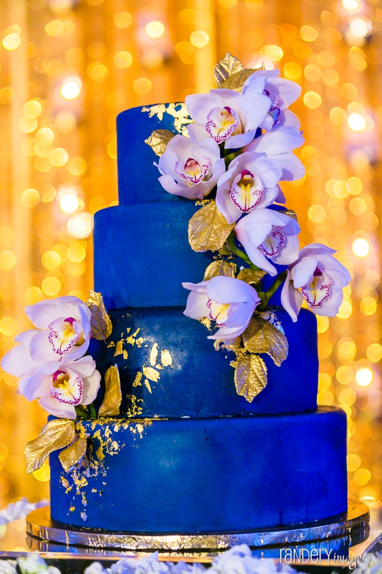 Stunning blue and gold orchid themed wedding cake