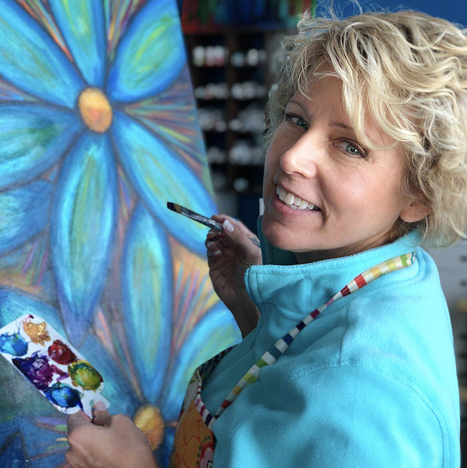 Sue Weiser Penn Wood   Sue is a mixed media artist who began painting at the age of twelve. She loves color and texture! She is a licensed artist with FreeSpirit Fabrics where they print her hand-painted art on fabric.