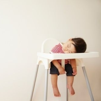 sleeping baby in high chair.jpg