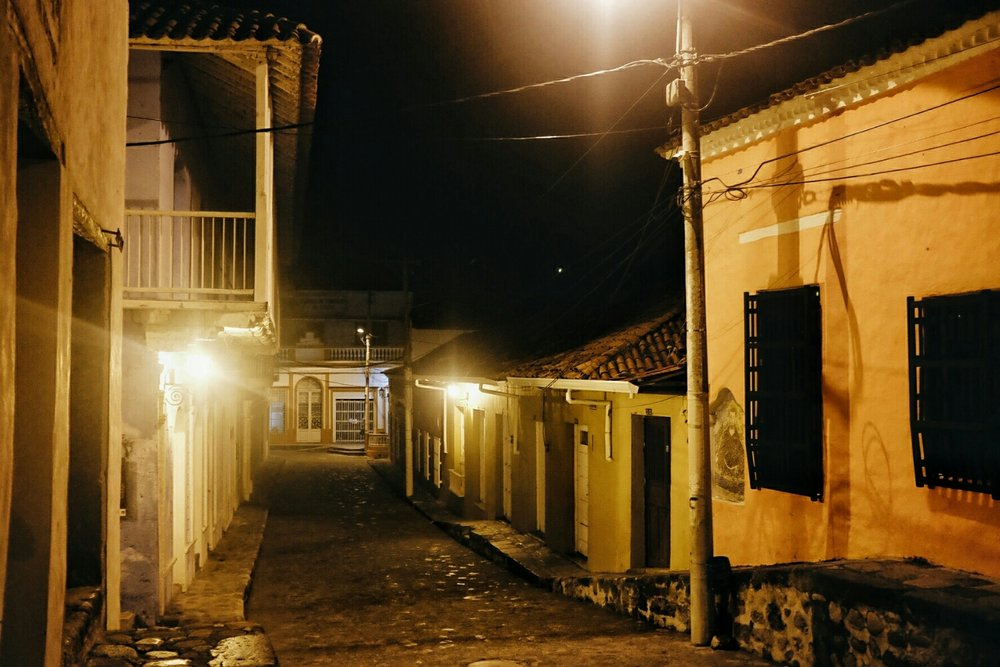 The rustic streets of Honda at night.