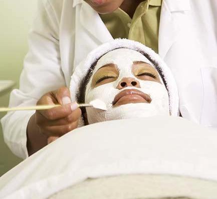 african_woman_receiving_spa_facial_treatment_bld052269.jpg