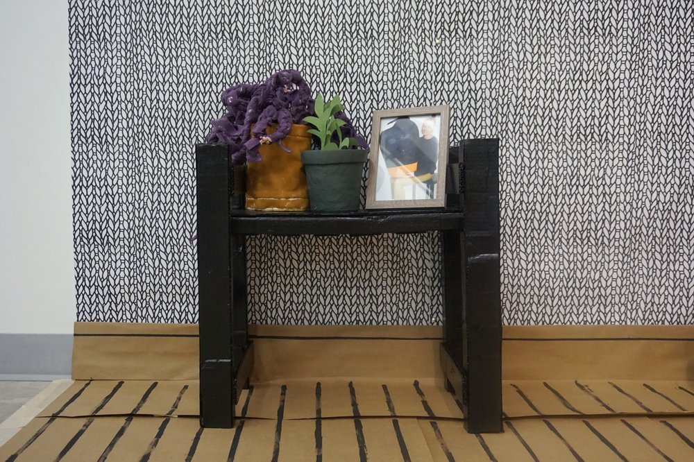 Shelf with Plants and Portrait