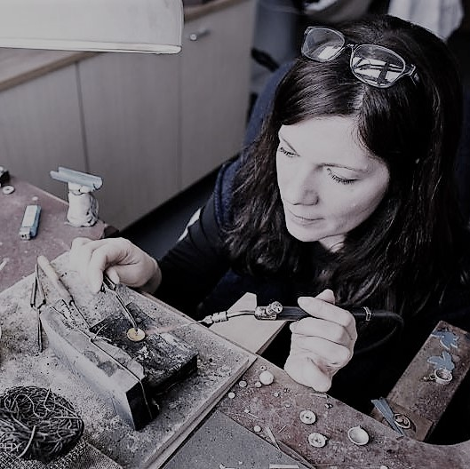 "Karen McKinley   Karen is apprentice-trained, and has been practicing her craft for over 20 years. She is an expert stonesetter and gemmologist. She specialises in reworking heritage jewellery into contemporary designs.   ""I love my job!"""